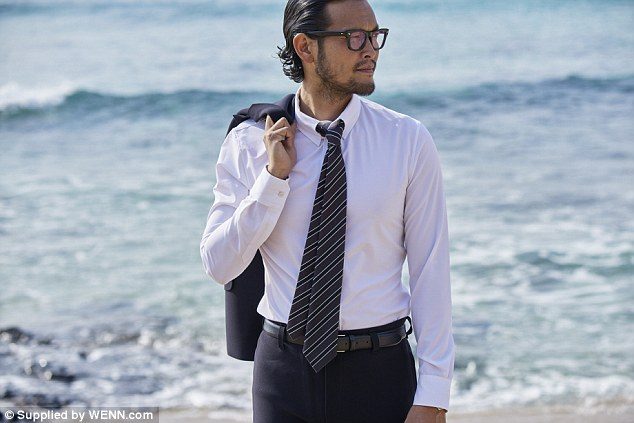 Do you see a suit with a shirt and tie walking along the beach casually? Yeah, me too!